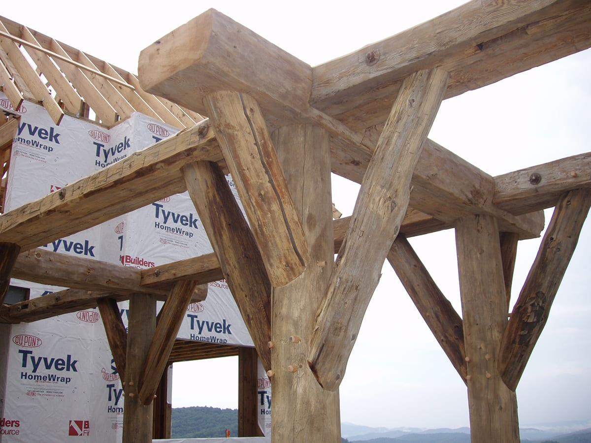 Post and beam framing reclaimed beam construction big for Post and beam construction