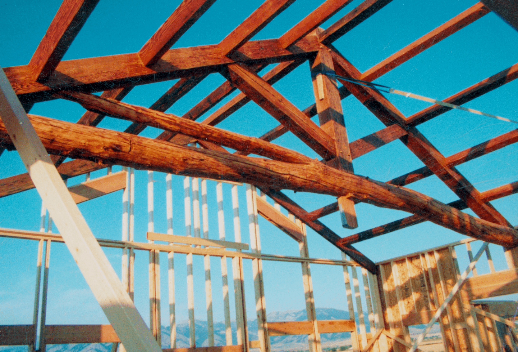 Extremely-unique-king-post-truss-raised-with-reclaimed-wood