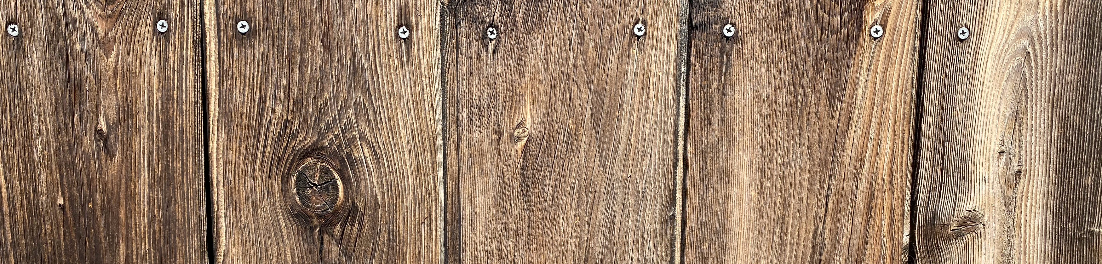 brown-reclaimed-wood-paneling-outside-siding